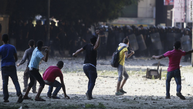 Protesters against the anti-Islam video confront police near the U.S. Embassy in Cairo on Friday.