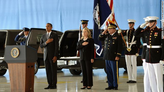 President Barack Obama and Secretary of State Hillary Clinton stand at Andrews Air Force Base as the bodies of the four Americans killed at the U.S. Consulate in Benghazi are returned.