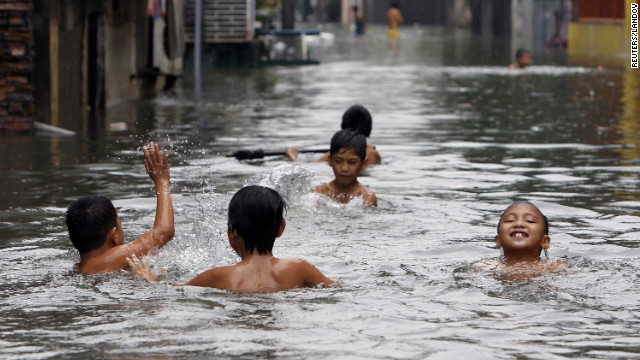 Children swim in water on a flooded street in San Juan, metro Manila on Saturday. <a href='http://www.cnn.com/2012/08/07/world/gallery/philippines-flooding/index.html'>See photos of last month's flooding in Manila from monsoon rains.</a>