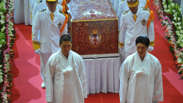 Hyung Jin Moon, left, Sun Myung Moon's youngest son and successor and Hyung Jin's brother Guk Jin (right), leader of businesses operated by the Unification Church, lead a funeral procession for their father.