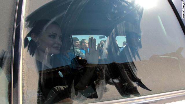 Jolie waves to the crowd as she arrived at Al Za'atri refugee camp on Wednesday.