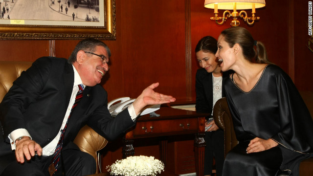 Jolie meets with Turkish Interior Minister Idris Naim Sahin in Ankara on Thursday. About 80,000 refugees are encamped in southeastern Turkey, near the Syrian border.