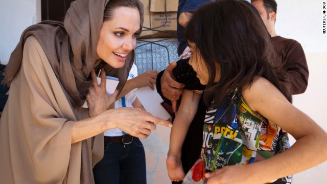 Jolie meets Syrian refugees in Lebanon's Bekaa Valley in September 2012 in her role as UNCHR special envoy.