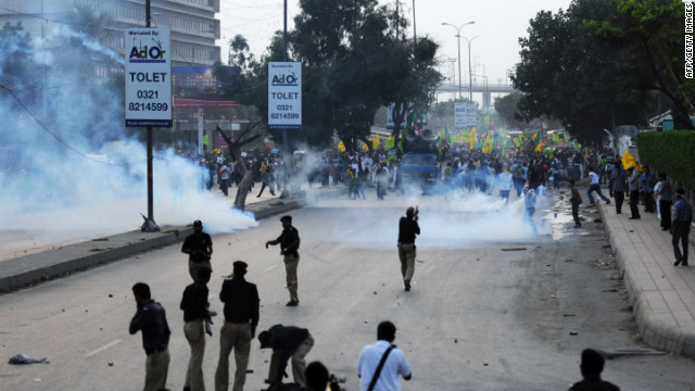 Pakistani police fire tear gas shells toward the protesters in Karachi on Sunday.