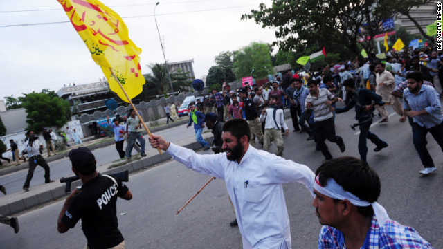 Pakistani protesters march toward the U.S. Consulate in Karachi on Sunday.