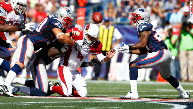 Quarterback Kevin Kolb of the Arizona Cardinals fumbles the ball into the hands of Mike Adams of the New England Patriots during the game on Sunday.