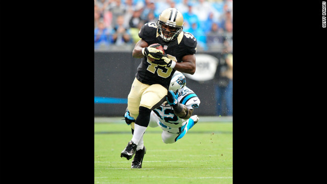 Jon Beason of the Carolina Panthers dives to bring down Darren Sproles of the New Orleans Saints on Sunday.