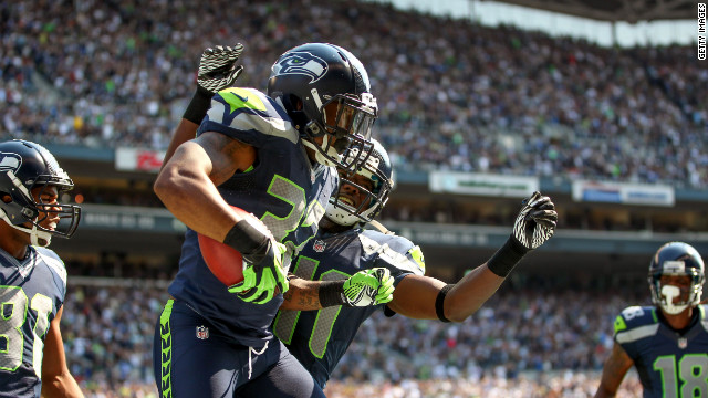No. 32 Jeron Johnson of the Seattle Seahawks celebrates with No. 41 Byron Maxwell after recovering a blocked punt and returning it for a touchdown against the Dallas Cowboys on Sunday.