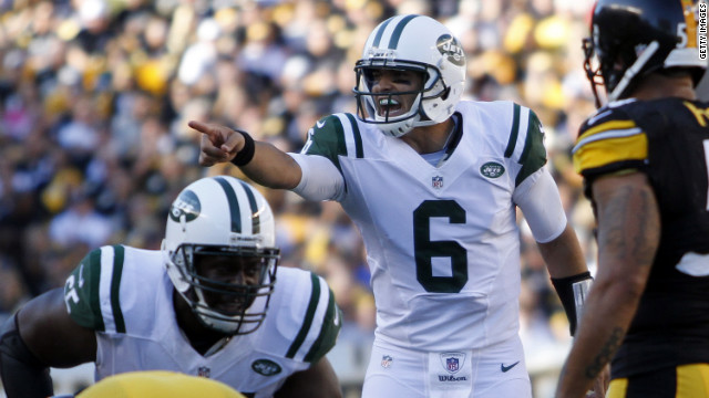 Mark Sanchez of the New York Jets directs the offense in Sunday's game against the Pittsburgh Steelers.