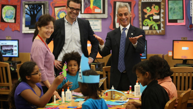 Chicago Mayor Rahm Emanuel, right, visits schoolchildren at Woodson Regional Library on Monday. The library is one of 78 public libraries in the city serving as &quot;safe havens&quot; for students who are not in school because of the strike.