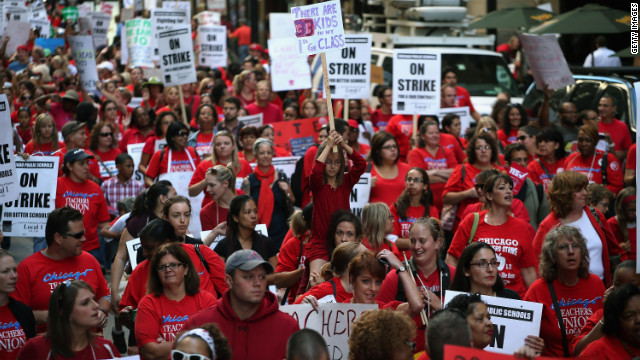 Thousands of teachers and their supporters march in front of the Chicago Public Schools headquarters on Monday. With more than 350,000 students, Chicago is home to the nation's third-largest school system.