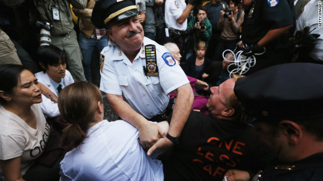 Protesters affiliated with Occupy Wall Street are arrested while attempting to form a &quot;People's Wall&quot; to block Wall Street on Monday.