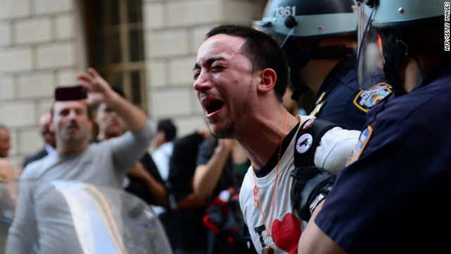 A participant in the Occupy Wall Street protest is arrested during a rally to mark the one-year anniversary of the movement in New York on Monday, September 17.