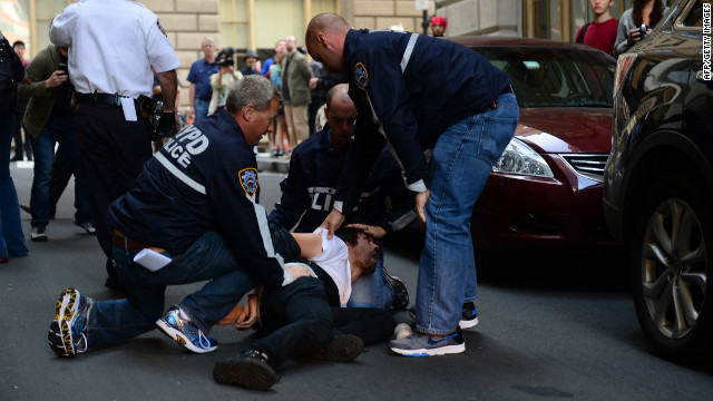 An Occupy Wall Street participant is arrested by police on Monday.