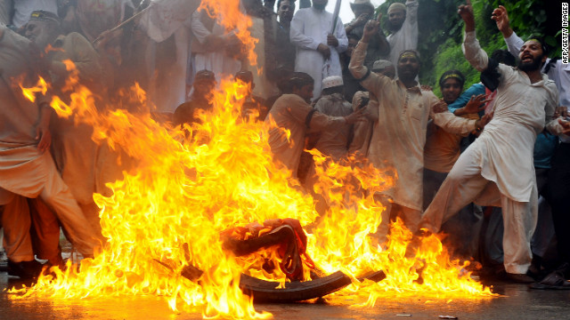 Sunni Muslims burn a U.S. flag during a protest in Lahore, Pakistan, on Monday, September 17. Protests sparked by an online film that mocks the Prophet Mohammed entered their second week, with demonstrators taking to the streets in Pakistan, Afghanistan, Indonesia and Lebanon.