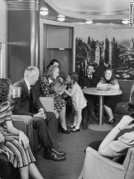 Passengers circa 1930 enjoy the observation car on the new streamlined 20th Century Limited shown here, with luxury service between New York and Chicago. 