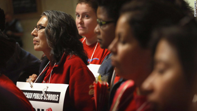 Striking teachers attend a news conference by the Chicago Teachers Solidarity Campaign outside the office of Mayor Rahm Emanuel in Chicago on Monday, September 17. Emanuel sought court action to force teachers back to work.