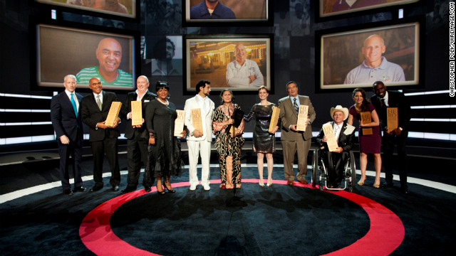 Last year's top 10 CNN Heroes join Anderson Cooper, far left, on stage at the Shrine Auditorium in December.