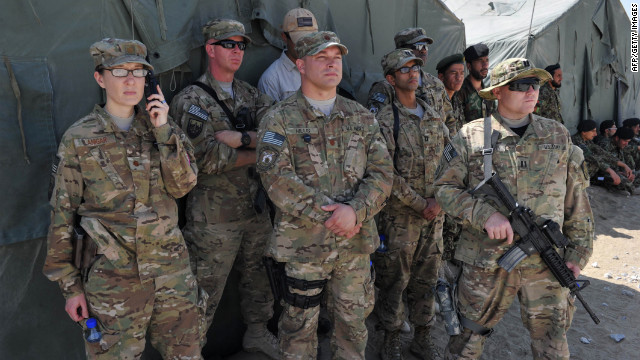 U.S. soldiers watch as the Bagram prison is turned over to Afghan authorities at the U.S. airbase in Bagram on September 10.