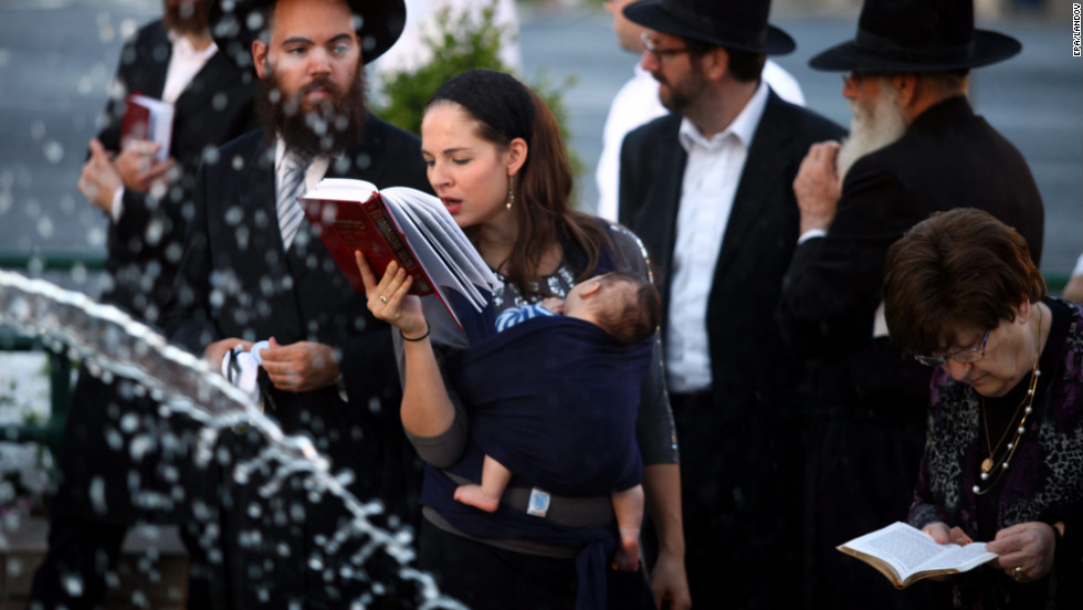 Orthodox Jews pray as they perform Tashlich, or the casting off, at the Paris Square fountain in central Jerusalem on Monday, September 17. On the afternoon of Rosh Hashanah, the Jewish New Year, it is customary to throw pieces of bread or stones into a large, natural body of flowing water to cast away the sins of the past year.
