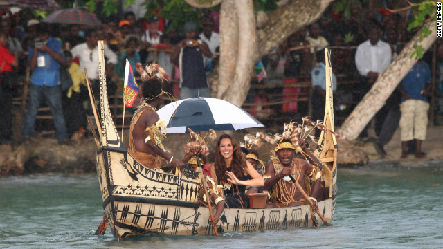 Catherine, Duchess of Cambridge, and Prince William travel in a traditional canoe during a visit to Tuvanipupu Island in the Solomon Islands on Monday.
