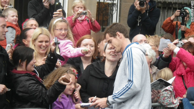 Murray, who beat Novak Djokovic in five sets to clinch his first grand slam title, spent four-and-a-half hours signing autographs and playing tennis with young fans at his former club.