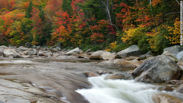 Tourists flock to New Hampshire to see the peak foliage along the Kancamagus Highway, shown here at the Lower Falls of the Swift River.