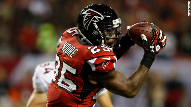 William Moore of the Atlanta Falcons intercepts a pass intended for Jacob Tamme of the Denver Broncos on Monday. Broncos quarterback Peyton Manning threw three interceptions in the first quarter.