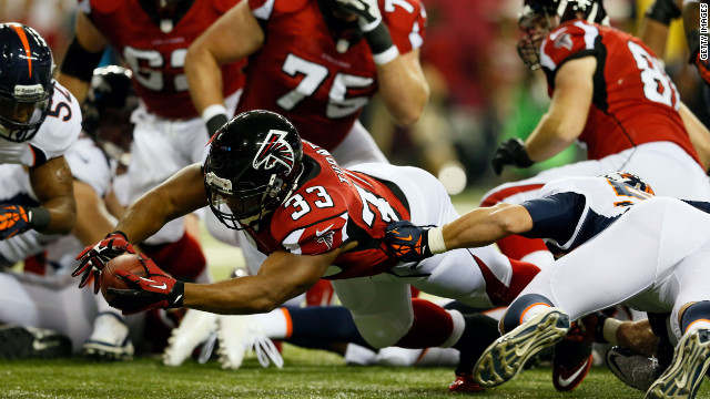 Running back Michael Turner of the Atlanta Falcons dives on a touchdown attempt in the first quarter against the Denver Broncos on Monday.