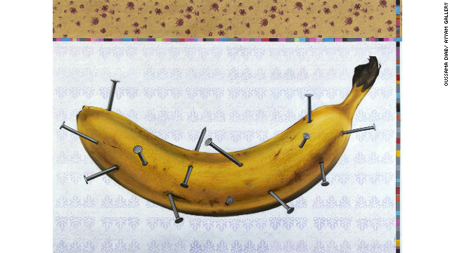 The banana represents a sensitive person who is suffering from the nails sticking into him, said Oussama Diab. The artwork is called &quot;Human Being.&quot;