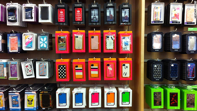 iPhone cases lined up on a wall at the San Francisco Apple store.