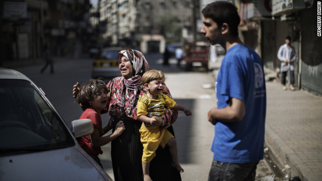 Members of a Syrian family cry outside an Aleppo hospital after surviving a strike by Syrian regime forces on Tuesday.