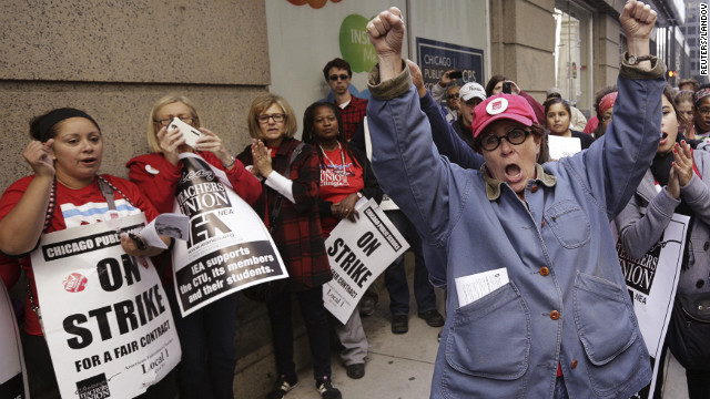 Chicago Teachers Union members picket outside Chicago Public Schools headquarters Tuesday, September 18, as their strike canceled classes for a seventh day. School officials went to court Monday to ask a judge to declare the strike illegal and order the teachers back to work. Union representatives will reconvene Tuesday afternoon to discuss a proposed deal.