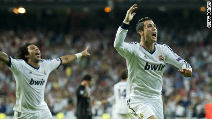 Football: Madrid late show sinks Man City