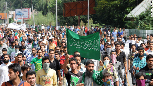 Kashmiri Muslim demonstrators shout anti-U.S. and Israeli slogans before a clash with Indian police during a protest and one-day strike called by several religious and political organizations in Srinagar on Tuesday.