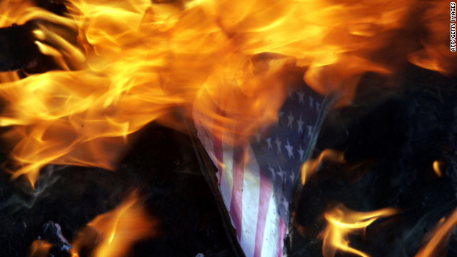 Indian Muslims burn an American flag with a picture of U.S. President Barack Obama as they protest against a U.S.-made anti-Islam film on Tuesday, September 18, near the U.S. Consulate in Chennai. About 5,000 people have gathered in front of the building. Google India has already blocked access to the film, which the government has condemned as