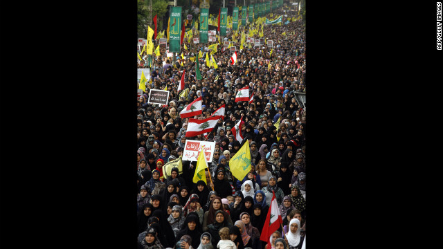 Supporters of Lebanon's Hezbollah group march during a rally in southern Beirut to denounce the film mocking Islam on Monday, September 17. Hezbollah chief Hassan Nasrallah, who made a rare public appearance at the rally, has called for a week of protests across the country over the film, describing it as the 