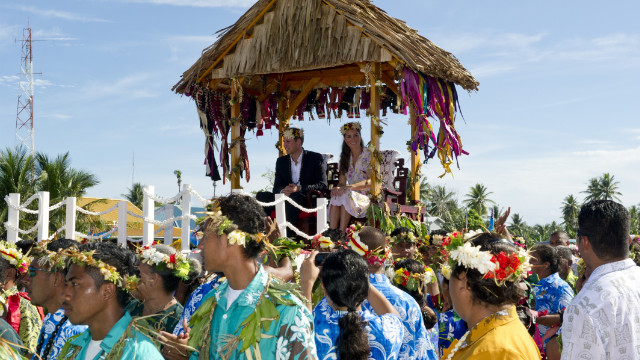 Prince William and Catherine, Duchess of Cambridge, are carried as they bid farewell in Tuvalu on Wednesday, September 19. The Duke and Duchess of Cambridge -- on a tour marking the diamond jubilee of Queen Elizabeth II -- are visiting Singapore, Malaysia, the Solomon Islands and Tuvalu. <a href='http://www.cnn.com/SPECIALS/world/photography/index.html' target='_blank'>See more of CNN's best photography</a>.