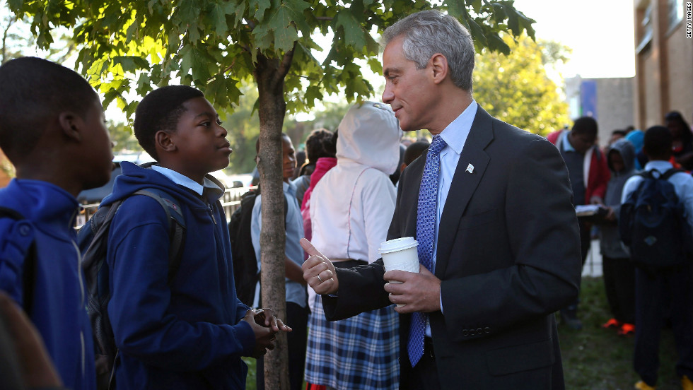 Mayor Rahm Emanuel greets students as they arrive at Frazier International Magnet School on Wednesday, September 19, in Chicago. Wednesday was the first day back for students and teachers after union representatives voted to suspend the eight-day strike.