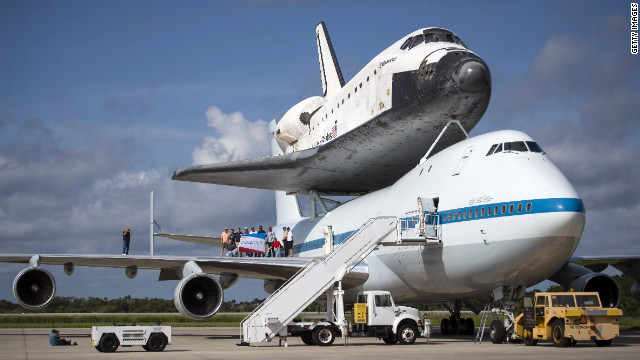 Workers pose for a photograph on the wing of NASA's Shuttle Carrier Aircraft Wednesday, with the space shuttle Endeavour perched on top.