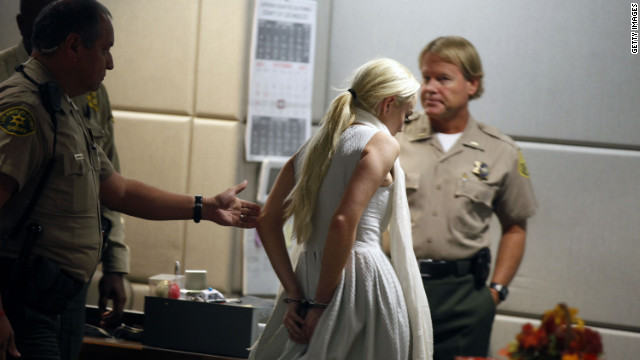 Lohan is led away in handcuffs at her probation progress report hearing at the Airport Courthouse in October 2011. 
