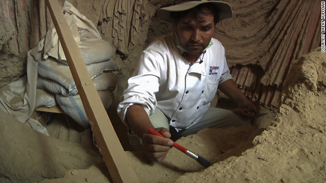 Abdul Qadeer Temore, lead Afghan archaeologist, works on one of the large standing Buddha statues.