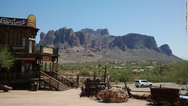 The Superstition Mountains rise up behind Goldfield Ghost Town along Arizona's Apache Trail. Goldfield is a restored ghost town settled by miners a hundred years ago. 