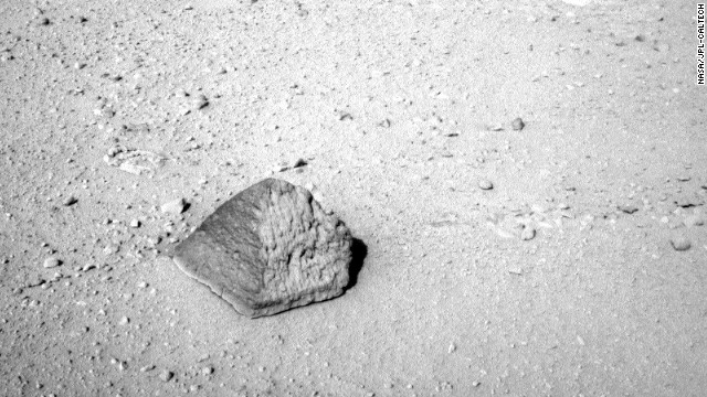 This rock will be the first target for Curiosity's contact instruments. Located on a turret at the end of the rover's arm, the contact instruments include the Alpha Particle X-Ray Spectrometer for reading a target's elemental composition and the Mars Hand Lens Imager for close-up imaging. 