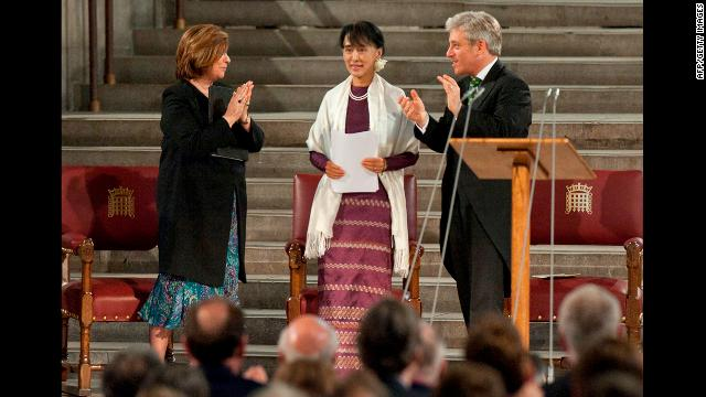 Suu Kyi stands to address both houses of Parliament in Westminster Hall, London, on June 21 as Speaker of the House of Commons John Bercow, right, and Speaker of the House of Lords Baroness D'Souza stand beside her. Suu Kyi made a historic address to both houses of the British Parliament, making her only the fifth foreign dignitary since World War II to be accorded the rare honor. 