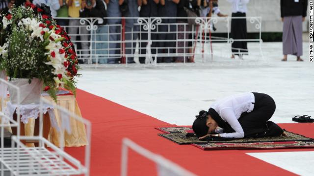 Suu Kyi prays in honor of her late father, independence hero Gen. Aung San, during a ceremony to mark the country's 65th anniversary of Martyrs' Day at the Martyrs' Mausoleum in Yangon, Myanmar, on July 19. The memorial is a tribute to Aung San and several other independence leaders who were killed on July 19, 1947. 