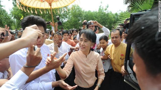Suu Kyi greets her supporters as she visits a recently flooded area in Pathein township, the capital city of the Irrawaddy division, on September 1. Heavy monsoon rains in Myanmar forced tens of thousands of people to seek shelter in emergency camps.