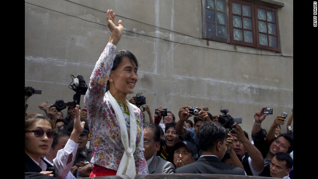 Suu Kyi waves to Burmese workers on a trip to a migrant community outside of Bangkok on May 30 in Samut Sakhon, Thailand. Suu Kyi pledged to help improve the rights of Burmese nationals living in Thailand.