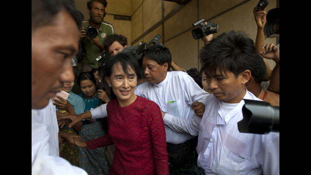Suu Kyi is surrounded by media as she visits polling stations in her constituency during the parliamentary elections on April 1, in Kaw Hmu, Myanmar.
