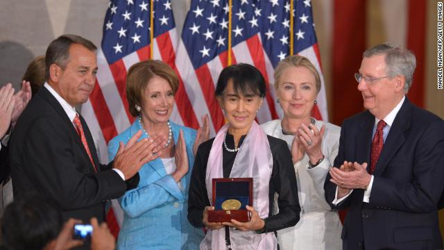 Suu Kyi, center, receives the Congressional Gold Medal. She is flanked by (from left) House Speaker John Boehner, House Minority Leader Nancy Pelosi, Secretary of State Hillary Clinton and Senate Minority Leader Mitch McConnell, right, stand with her.